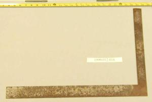 Primary view of object titled '[Rusty L-shaped carpenter's square]'.