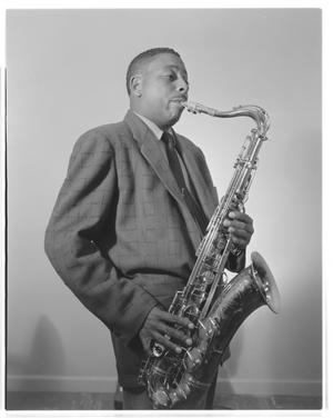 Primary view of object titled '[A photograph of a musician playing a tenor saxophone]'.