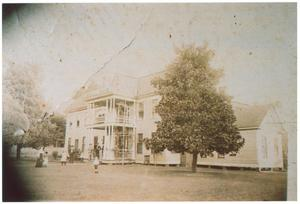Primary view of object titled '[Magnolia Place Hotel]'.