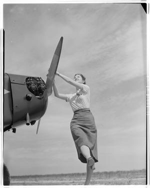 Primary view of object titled 'Unidentified Woman Starting a Plane'.