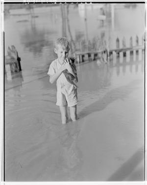 Primary view of object titled '[Photograph of an Unidentified Boy with a Kitten in Water]'.