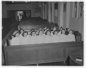 Nurses sitting in church pews