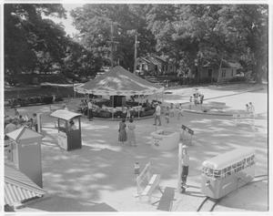 Primary view of object titled '[Children playing at Kiddie Land]'.