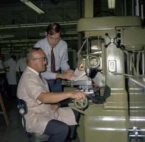 Two Unidentified Men at a Drill Press