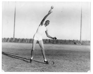 Primary view of object titled '[Male athlete putting the shot]'.