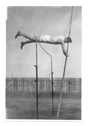 Primary view of object titled '[Photograph of Odus Mitchell in the 12 ft. pole vault in the early twenties]'.