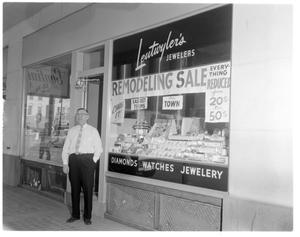 Primary view of object titled 'Mr. Leutwyler in front of store'.