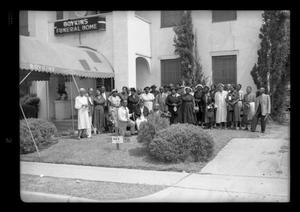 Primary view of object titled '[Photograph of a Group of People Outside Boykins Funeral Home]'.
