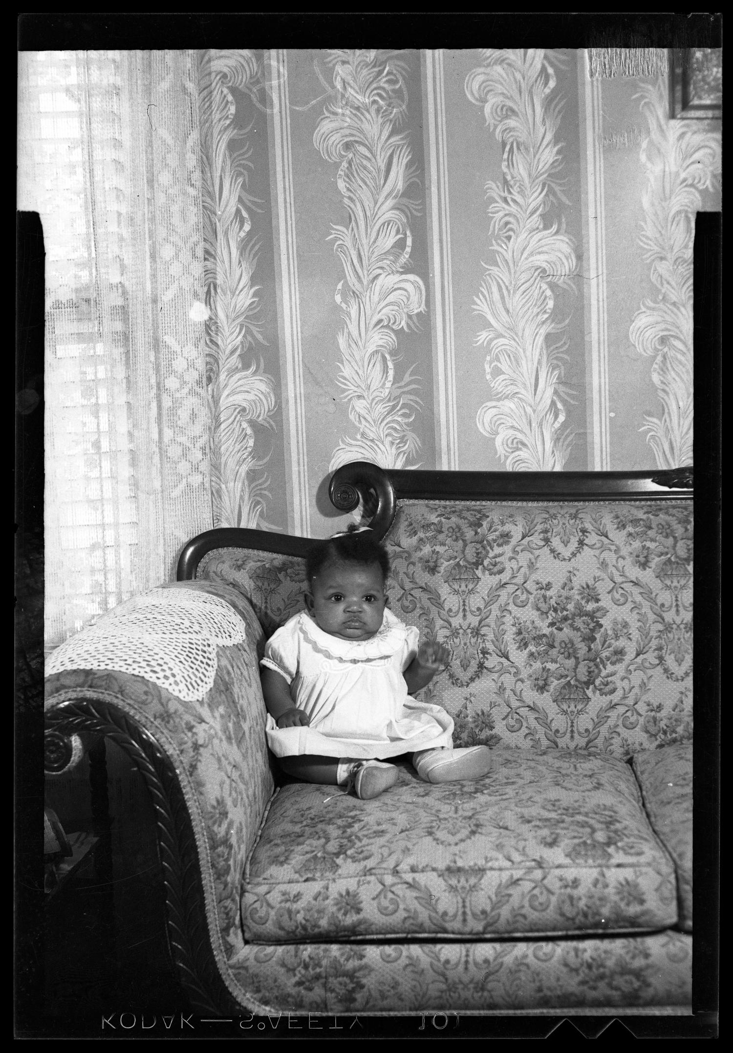 [Photograph of an Infant Child]                                                                                                      [Sequence #]: 1 of 1