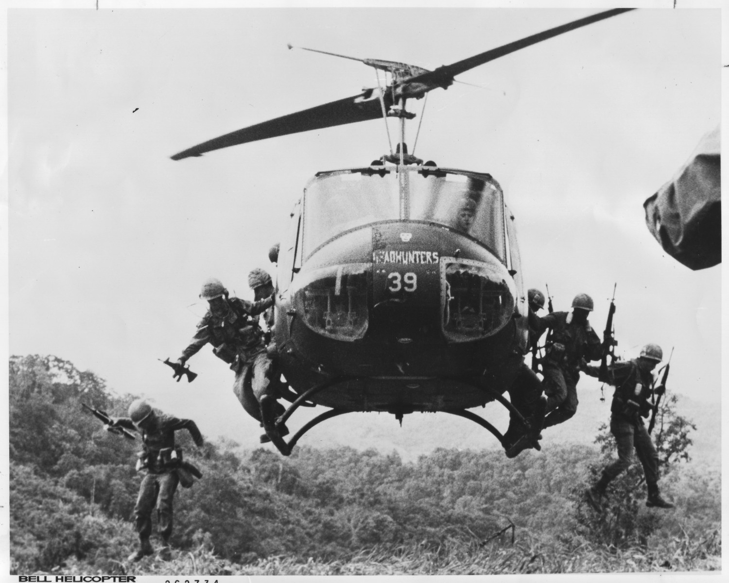 Soldiers Jumping Out Of A Helicopter In Combat