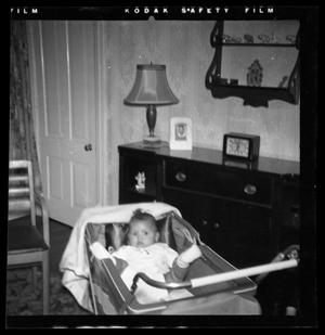 Primary view of object titled '[Photograph of an Infant Child in a Stroller]'.