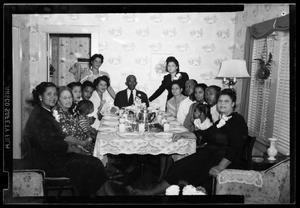 Primary view of object titled '[Photograph of People Sitting at a Dining Table]'.