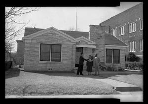 Primary view of object titled '[Photograph of Three People in Front of a House]'.