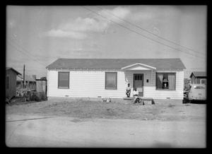 Primary view of object titled '[Photograph of Two Men in Front of a Building]'.
