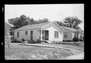 Primary view of object titled '[Photograph of a Row of Houses]'.