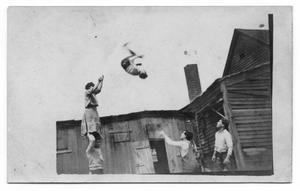 Primary view of object titled '[Abreu Troupe Performing a Stunt]'.