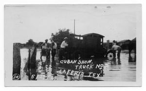 Primary view of object titled '[Carpe Cubaba's Show Truck in Flood Water]'.