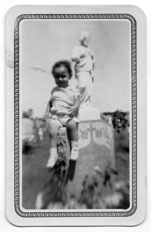 Primary view of object titled '[Photograph of Toddler on Gravestone]'.