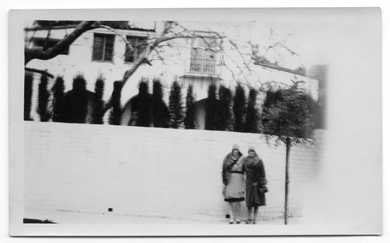Two Women in Front of Mansion                                                                                                      [Sequence #]: 1 of 2
