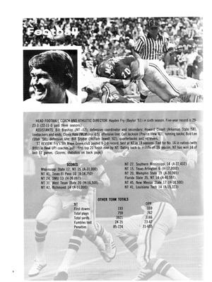 Page with a picture of a football game in the top quarter, with a smaller picture of a man within it. Rest of page has names and statistics of the game.