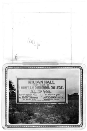 "Primary view of object titled '""Kilian Hall"" sign standing on ground'."