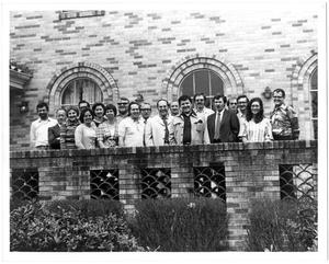 Faculty and staff in front of Texas Hall