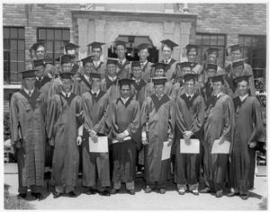Primary view of object titled 'Graduates standing in front of Kilian Hall'.