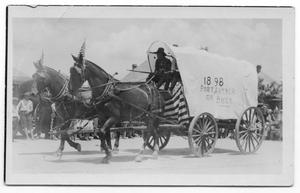 Primary view of object titled '[Covered wagon in parade]'.