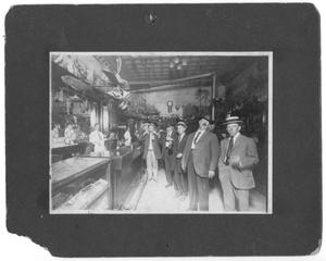 Primary view of object titled '[Men Drinking at Bar]'.
