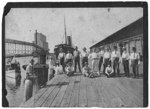 Primary view of object titled '[Men Standing on Grain Dock]'.