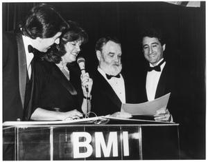 Primary view of object titled '[Photograph of Bill Hall At a Podium During a BMI Event]'.