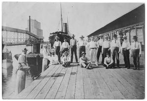 Primary view of object titled '[Photograph of Men On a Dock, August 10, 1901]'.