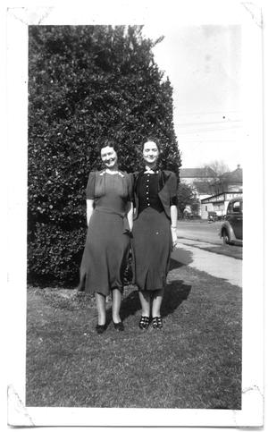 Primary view of object titled '[Two Women Standing Outside Near Sidewalk]'.
