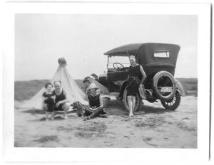 Primary view of object titled '[Family on Beach Next to Automobile]'.