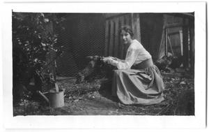 Primary view of object titled '[Woman Feeding Rabbit]'.