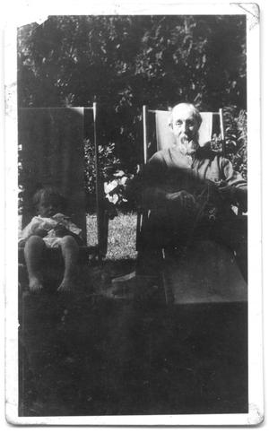 Primary view of object titled '[Elderly Man and Toddle Sitting Outside]'.