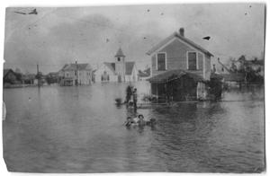 Primary view of object titled '[Photograph of Flooded Houses and a Church]'.