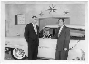 Primary view of object titled 'John and Ted Clegg in Lincoln-Mercury Showroom, 1957'.