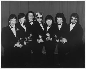 Primary view of object titled '[Photograph of the Band Members of Toto Holding Grammy Awards]'.