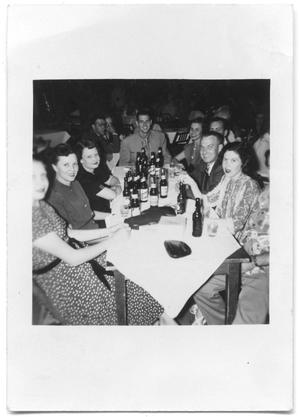 Primary view of object titled '[Photograph of A Group at a Table in Dessau Hall]'.