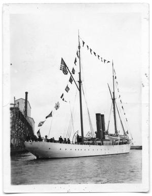 Primary view of object titled '[Boat With Flags at Dock]'.
