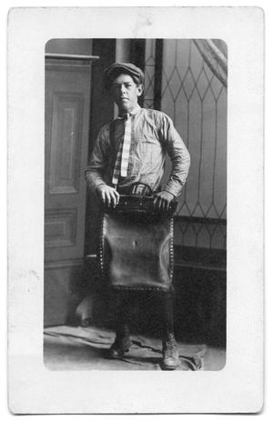 Primary view of object titled '[Portrait of Mail Boy at Texas Company Terminal]'.