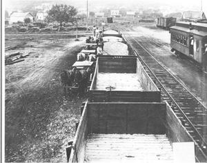 Primary view of object titled '[Unloading Grain From Box Cars]'.