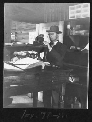 [Southern Pine Lumber Company Worker with Record Books]