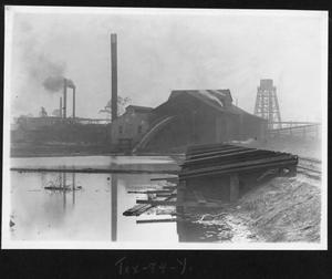 Primary view of object titled '[Southern Pine Lumber Company Sawmill view from the Mill Pond]'.