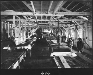 Primary view of object titled '[Southern Pine Lumber Company Sawmill 2 Interior - South]'.