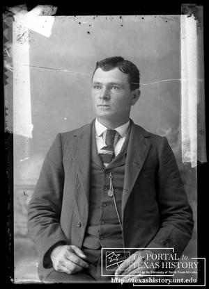 Primary view of object titled '[Young man in three piece suit]'.
