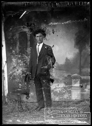 Primary view of object titled '[Young man in tie and suit]'.