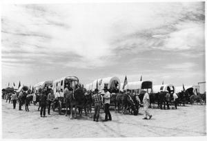 Primary view of object titled 'Texas Sesquicentennial Wagon Train on Its Way from Windthorst to Wichita Falls'.