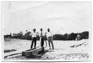 Primary view of object titled '[Photograph of Reservoir Construction Managers at White Rock Creek]'.